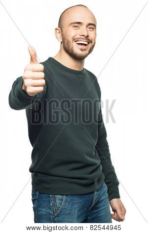 Happy young man showing thumbs up, against white background