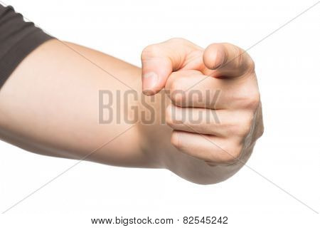Closeup of male hand pointing at viewer. Isolated on white background
