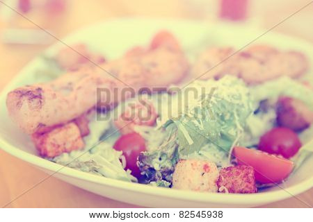 Caesar salad with grilled chicken fillet, parmesan cheese and croutons, toned image