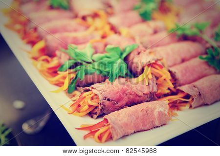 Rolls with roastbeef and vegetables, limited focus, toned image