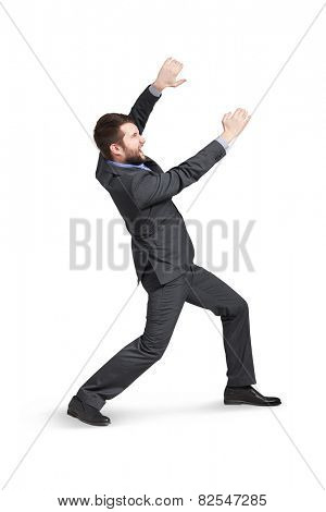 young man holding empty copycpace and screaming. isolated on white background