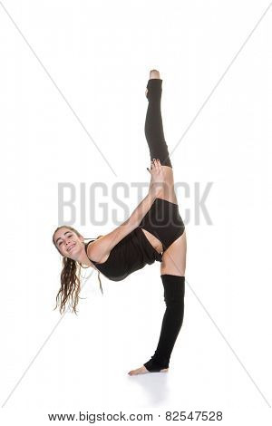 young woman exercising ballet or gymnastic stretches