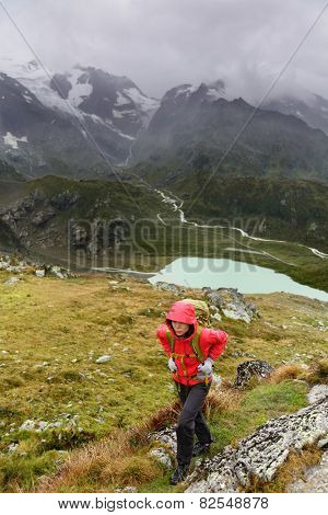 Hiking - hiker woman on trek with backpack living healthy active lifestyle. Hiker girl walking on hike in mountain nature landscape in Steingletscher, Urner Alps, Berne, Swiss alps, Switzerland.