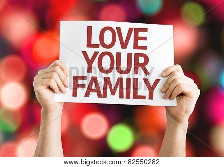 Love Your Family card with colorful background with defocused lights