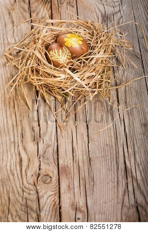Brown Eggs In A Nest