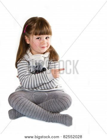 Smiling Little Girl Indicating The Something, White Background