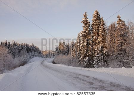 The Road Is Slippery In The Winter Forest.