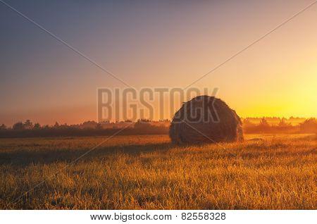 Haystack at dawn