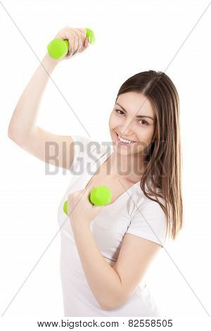 Smiling Young Woman Lifts Dumbbells