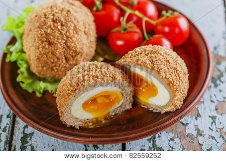 eggs on Scottish on a plate with cherry tomatoes