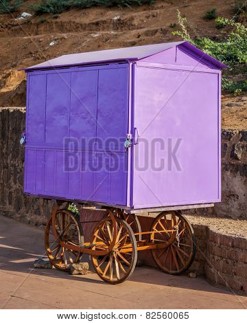 Street vendor (hawker) purple cart, India