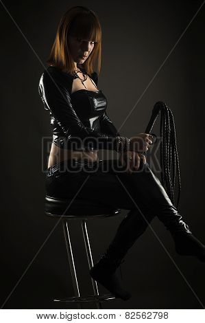 beautiful woman sitting on a bar stool