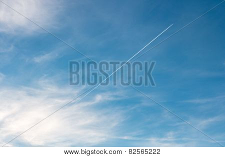 Airplane emerging from the clouds