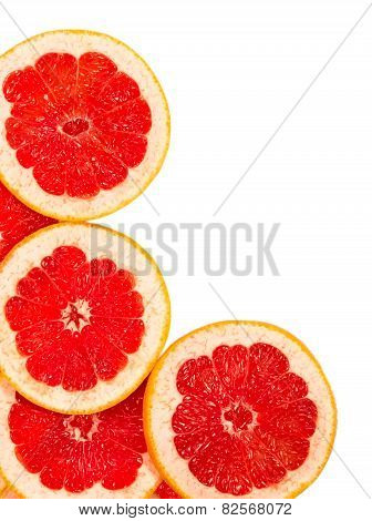 Fresh Grapefruit Slices Isolated On A White