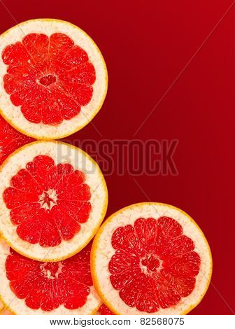 Fresh Grapefruit Slices Isolated On A Gradient Red