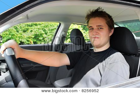 Teenage Male Behind The Driver's Wheel