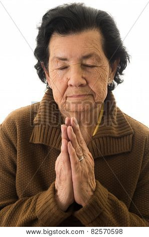 closeup shot of grandmother praying