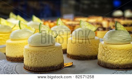 Round Cheese Cake With Cream On The Bakery Storefront