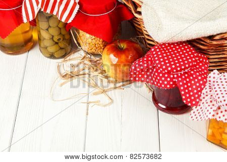 Preserves on white wood background.