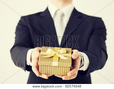 close up of man hands holding gift box.
