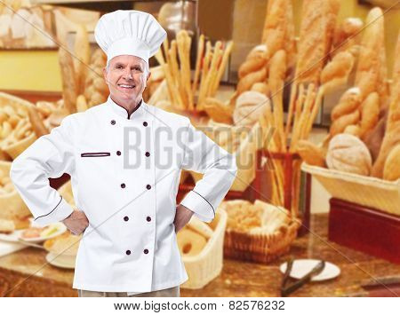 Mature professional chef man in modern restaurant.
