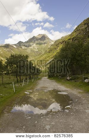 Mountain Path In Madesimo Valley Floor