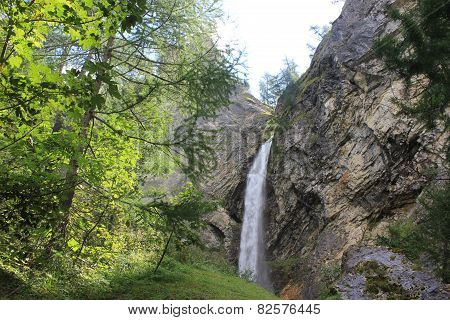 Waterfall Through Rocks In Madesimo