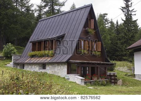 Traditional Mountain Chalet In The Summer Season