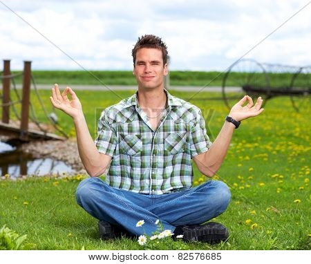 Man doing yoga in the park. Meditation and relaxation.