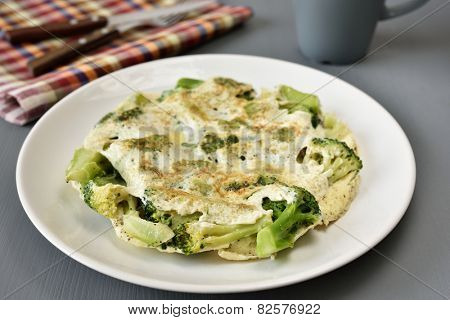 Omelet with broccoli on a plate