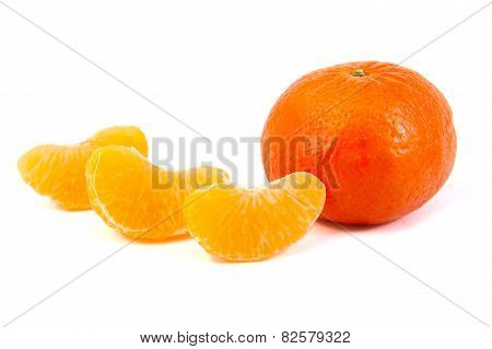 Three tangerine slices with a mandarin on white background