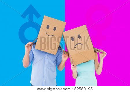 Couple wearing sad face boxes on their heads against female gender symbol