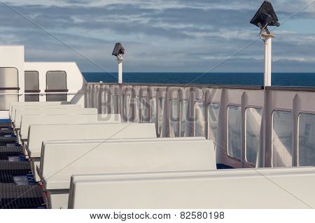 Empty White Benches On Ferry Boat In Open Sea