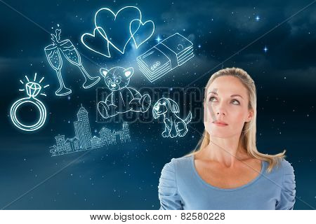 Thinking pretty blonde looking up against stars twinkling in night sky