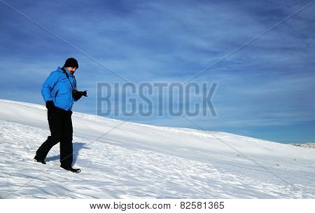 Nature photographer trekking in the mountains