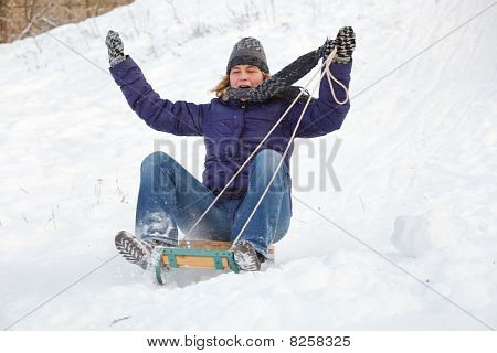 Woman Having Fun In Snow