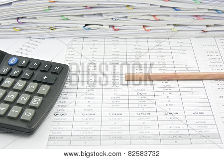 Bottom Of Brown Pencil And Calculator On Finance Account
