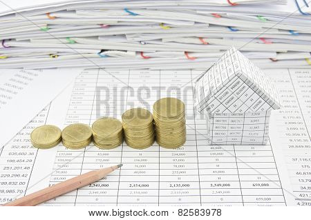 Step Of Gold Coin Near And House With Pencil