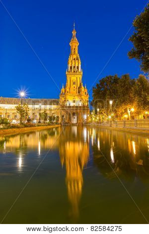 Spanish Square espana Plaza in Sevilla Spain at dusk with its reflection on pond
