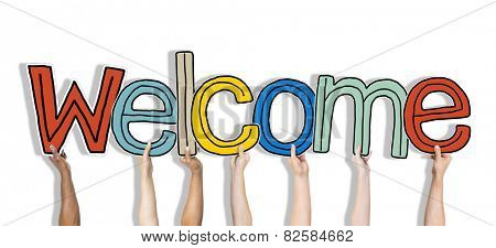 Group of Hands Holding Word Welcome