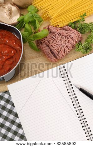 Cookbook With Ingredients For Spaghetti Bolognese