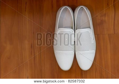 Male dress shoes, elegant wedding groom boots called derby shoes, leather white cloth empty shoes in horizontal orientation, nobody