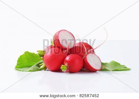 Fresh red radishes on white background