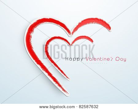 Creative hearts with red splash for Happy Valentine's Day celebration on shiny sky blue background.