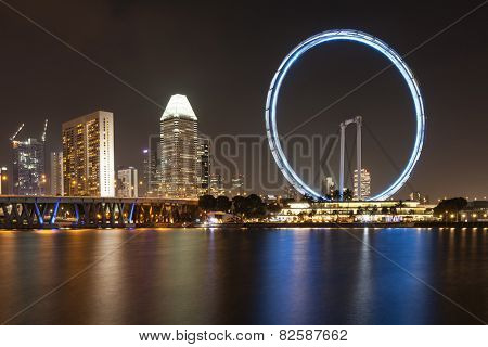 SINGAPORE - DECEMBER 10: Night view of the Singapore Flyer December 10, 2014 in Singapore. City skyline at night
