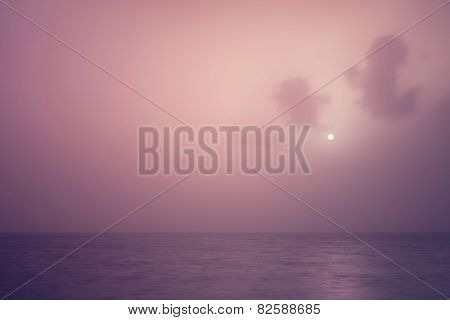 Beautiful seascape, gorgeous purple sunset over calm sea, abstract natural background, romantic evening, tranquil panorama, beauty of nature concept