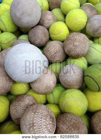 Softball With Tennis Ball In Iron Basket
