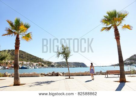 Port d'Andratx harbor, Mallorca - tourist woman walking in city in summer, Balearic Islands, Spain, Europe.