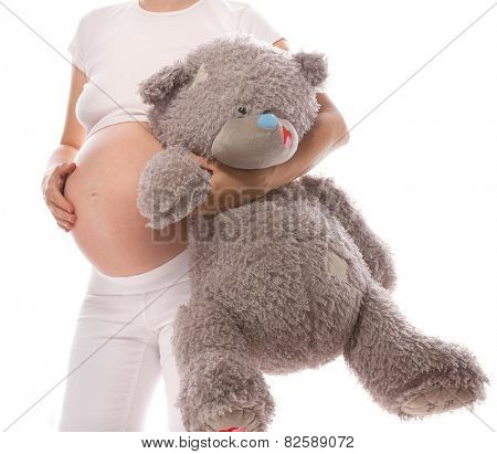 pregnant caucasian woman closeup body solated on white background studio shot teddy bear