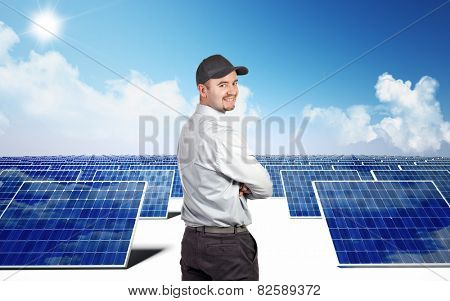 smiling worker and photovoltaic module